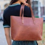 woman holding leather tote