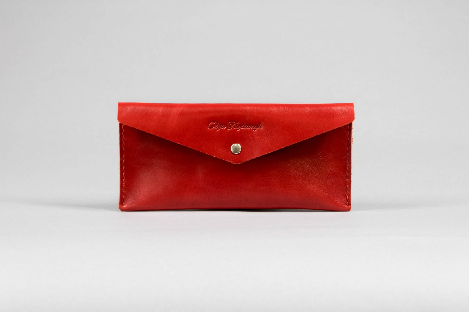 red leather coupon holder