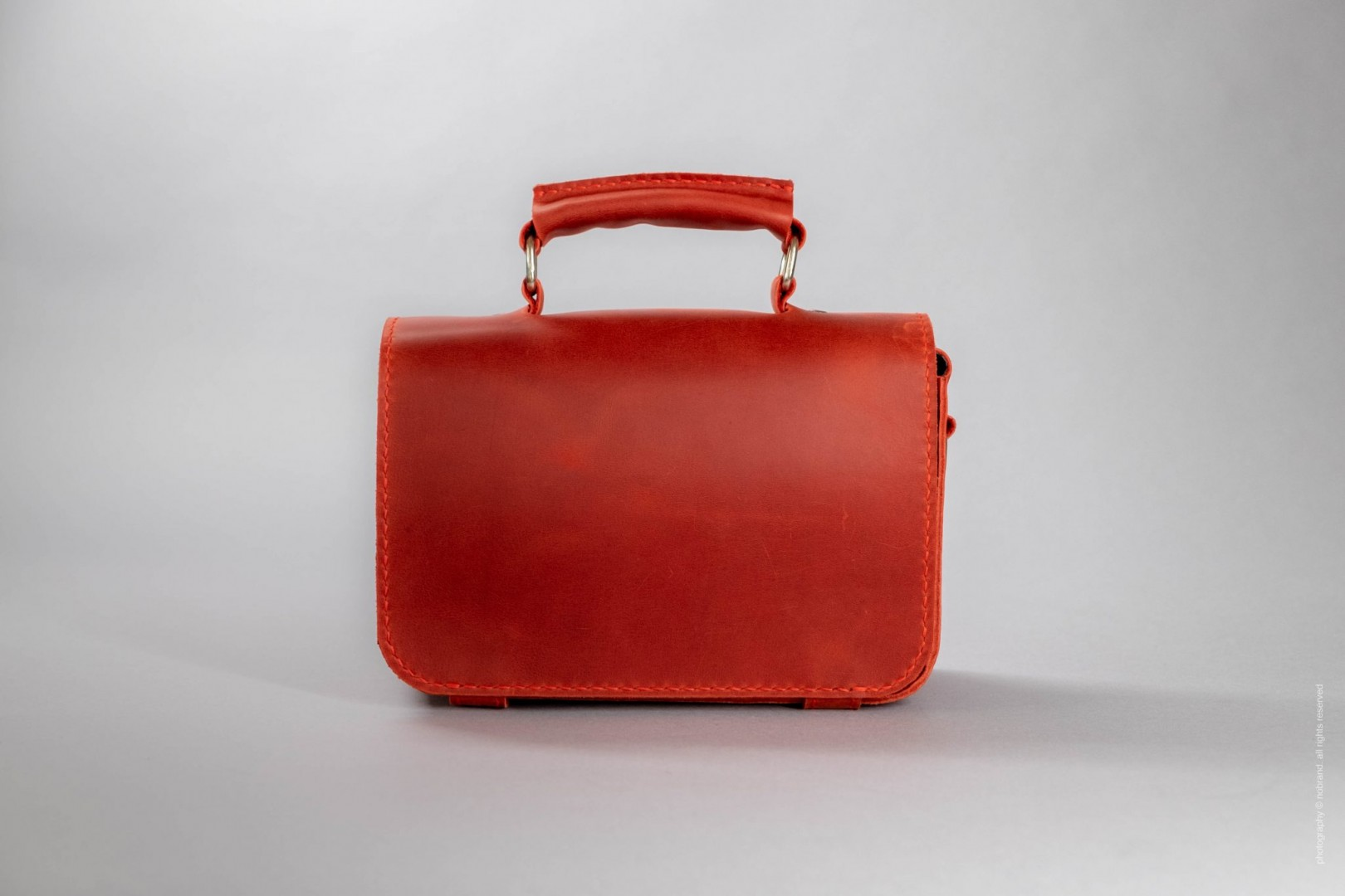red leather top handle purse